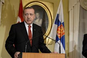 Turkey's PM Erdogan addresses reporters during a news conference at the Government Banquet Hall in Helsinki