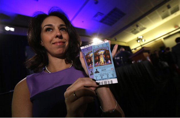 Anastasia Danias, vice president of legal affairs for the NFL, holds samples of legitimate tickets, at a news conference regarding counterfeit Super Bowl merchandise and tickets  for the upcoming Supe
