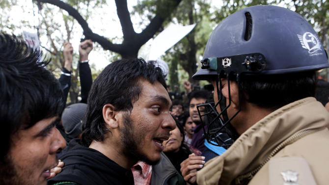 A member of the student wing of India's main opposition Bharatiya Janata Party confronts a policemen during a protest after the death of a young woman who was recently gang-raped in a moving bus in New Delhi, Sunday, Dec. 30, 2012. The young woman who died after being gang-raped and beaten on a bus in India's capital was cremated Sunday amid an outpouring of anger and grief by millions across the country demanding greater protection for women from sexual violence. (AP Photo/ Dar Yasin)