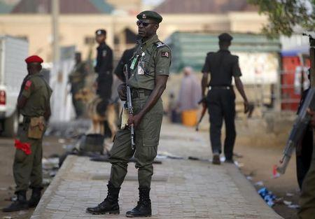 Policemen stand guard near Independent National Electoral Commission in Kano