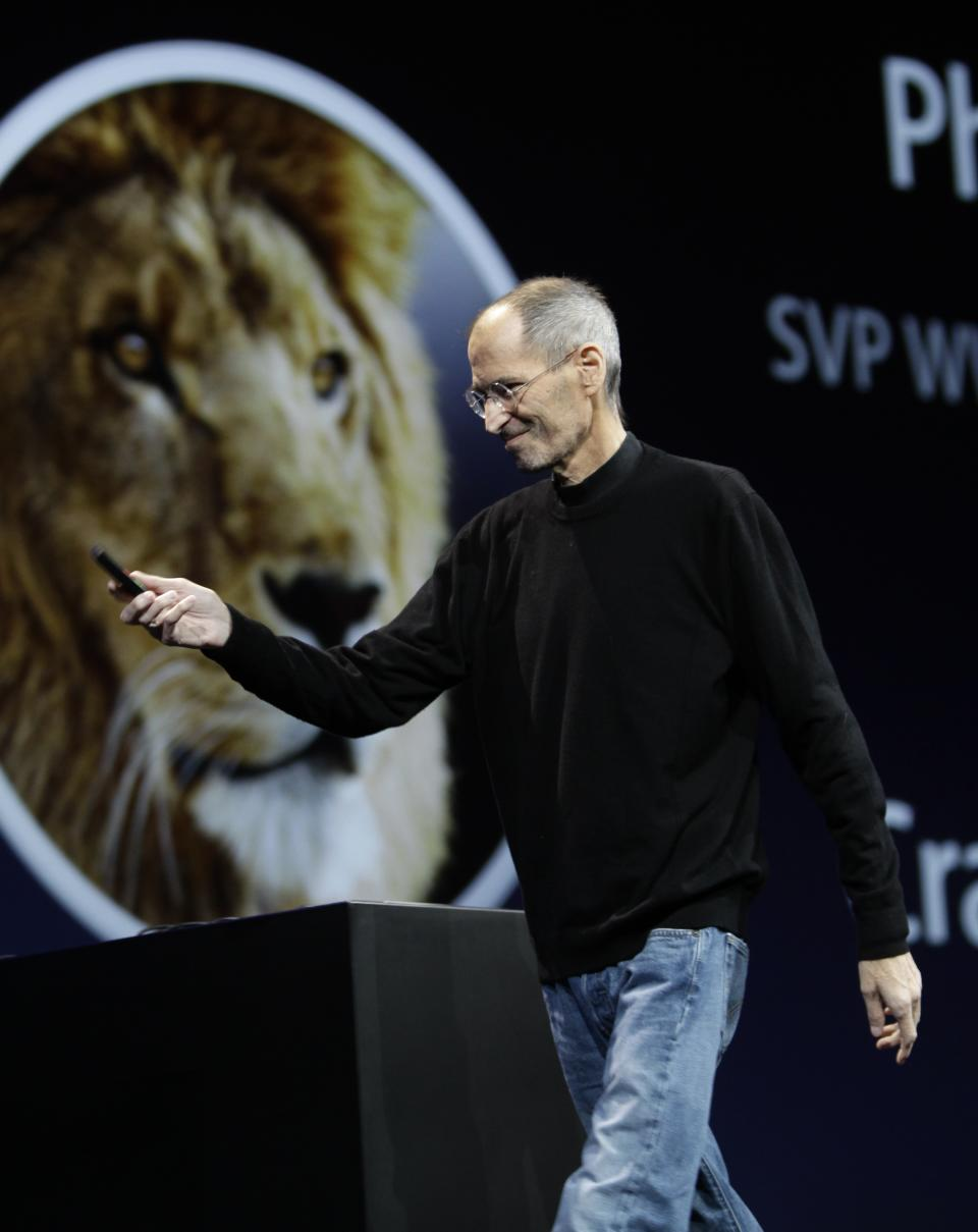 Apple CEO Steve Jobs talks about Lion during a keynote address to the Apple Worldwide Developers Conference in San Francisco, Monday, June 6, 2011.  (AP Photo/Paul Sakuma)