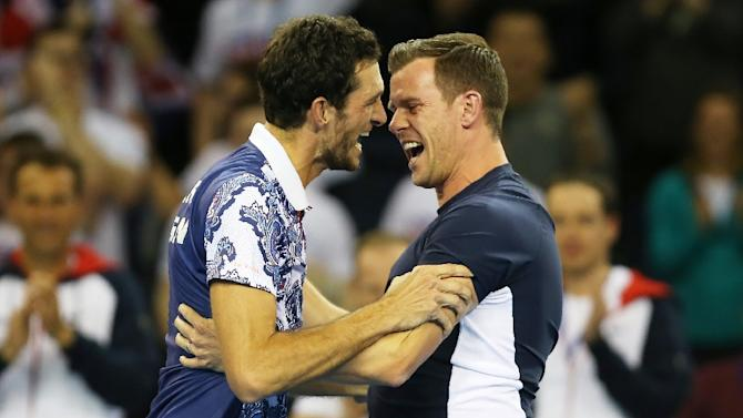 Great Britain's James Ward (L) celebrates with team captain Leon Smith after winning his Davis Cup World Group first-round singles tennis match against John Isner in Glasgow, Scotland, on March 6, 2015
