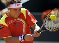 Spain's David Ferrer returns against American Sam Querrey during the first match of their Davis Cup semi-final at the Hermanos Castro park court in Gijon, northern Spain. Ferrer won 4-6, 6-2, 6-2, 6-4