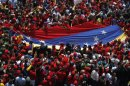 "Venezuela's Chavez exalted as ""father"" and ""martyr"" by followers"
