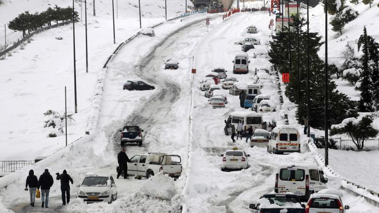 A general view shows cars stuck on a road in Jerusalem following a snowstorm