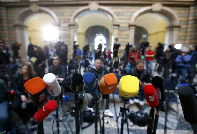 Media wait for the court spokesperson following the verdict in the tax evasion trial against Bayern Munich President Uli Hoeness at the regional court in Munich