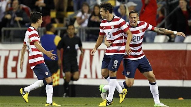 Herculez Gomez (C) of the U.S. celebrates after scoring a goal with teammates Jose Torres (L) and Geoff Cameron (20) during their 2014 World Cup qualifier against Jamaica (Reuters)