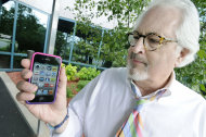 <p>               Bob Burns holds his smartphone Wednesday, June 27, 2012 in Minnetonka, Minn. Millions of smartphone users wiil soon begin receiving text messages about severe weather from a sophisticated government system that can send a blanket warning to mobile devices in the path of a dangerous storm. (AP Photo/Jim Mone)