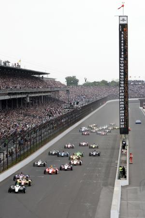 Ed Carpenter leads the field into the first turn at the start of the Indianapolis 500 auto race at the Indianapolis Motor Speedway in Indianapolis Sunday, May 26, 2013. (AP Photo/AJ Mast)