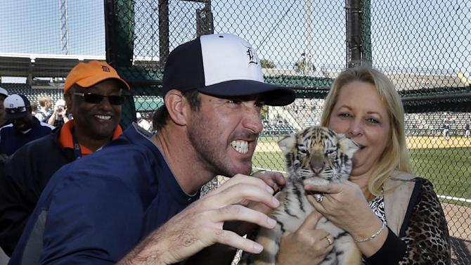 Detroit Tigers pitcher Justin Verlander poses with Rocky, a 4-week-old Bengal tiger from the Dade City Wild Things Zoo, before an exhibition spring training baseball game against the Tampa Bay Rays, Friday, March 29, 2013 in Lakeland, Fla. (AP Photo/Carlos Osorio)