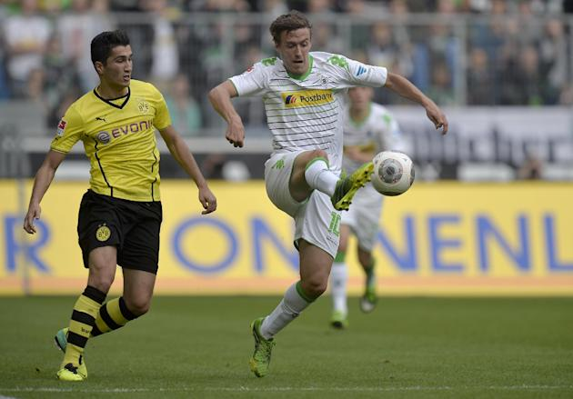 Moenchengladbach's Max Kruse, right, and Dortmund's Nuri Sahin of Turkey challenge for the ball during the German first division Bundesliga soccer match between Borussia Moenchengladbach and Borussia