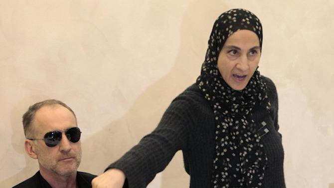 The mother of the two Boston bombing suspects, Zubeidat Tsarnaeva, with the suspects' father Anzor Tsarnaev, left, speaks at a news conference in Makhachkala, the southern Russian province of Dagestan, Thursday, April 25, 2013. The father of the two Boston bombing suspects said Thursday that he is leaving Russia for the United States in the next day or two, but their mother said she was still thinking it over. (AP Photo/Musa Sadulayev)