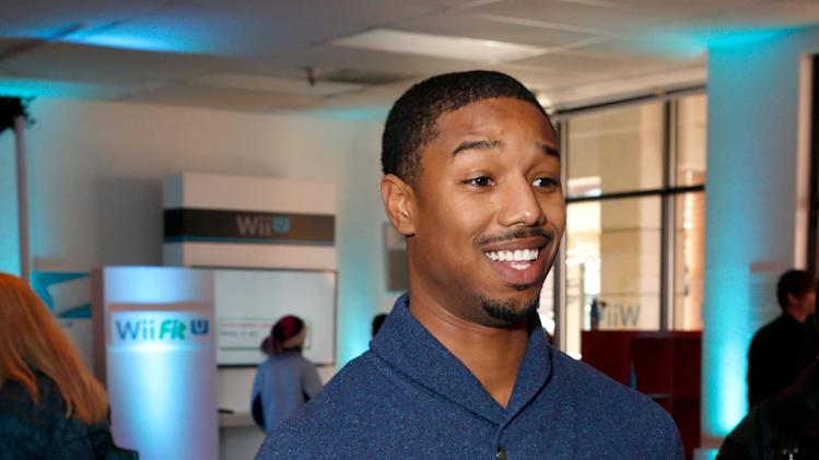 Actor Michael B. Jordan warms up and checks out Wii U at the Nintendo Lounge during a break from the Sundance Film Festival on Monday, Jan. 21, 2013 in Park City, Utah. (Photo by Todd Williamson/Invision for Nintendo/AP Images)