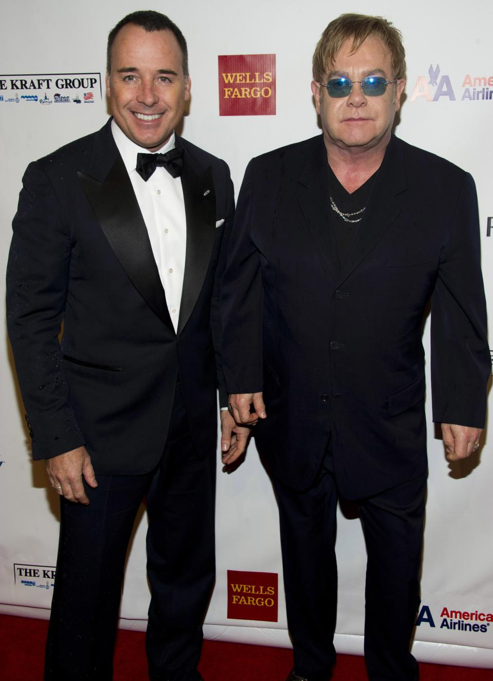 Elton John, right, and David Furnish attend Elton John's AIDS Foundation's 11th annual Enduring Vision benefit on Monday, Oct. 15, 2012  in New York.  (Photo by Charles Sykes/Invision/AP)