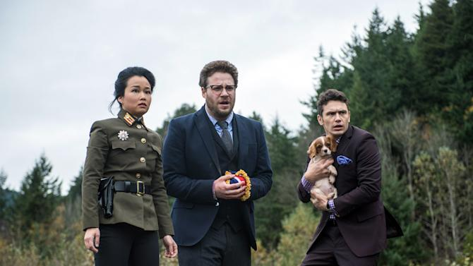 "This photo provided by Columbia Pictures - Sony shows, from left, Diana Bang, as Sook, Seth Rogen, as Aaron, and James Franco, as Dave, in Columbia Pictures' ""The Interview."" When a group claiming credit for the hacking of Sony Pictures Entertainment threated violence against theaters showing ""The Interview"" earlier this week, the fate of the movie was all but sealed. Even though law enforcement didn't deem the threats of violence credible, theater owners and Sony undoubtedly considered the 2012 massacre of a dozen people in a Colorado movie theater. That attack came without warning, and there was no precedent for such mass violence against a U.S. movie audience. (AP Photo/Columbia Pictures - Sony, Ed Araquel)"