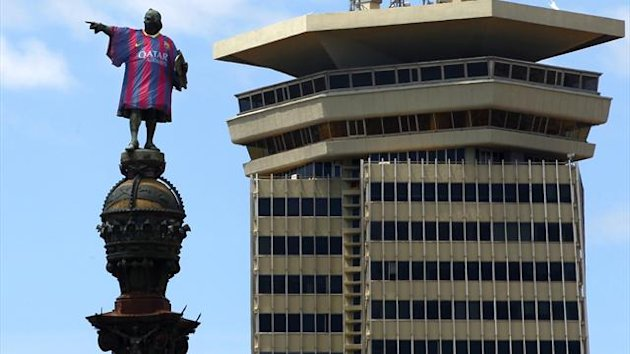 The statue of Christopher Colombus wears the new Barcelona top (Reuters)