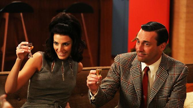 """This publicity photo provided by AMC shows Jessica Pare as Megan Draper, left, and Jon Hamm as Don Draper in a scene of """"Mad Men,"""" Season 6, Episode 2. """"Mad Men"""" returns for its sixth season Sunday, April 7, 2013. (AP Photo/AMC, Michael Yarish)"""