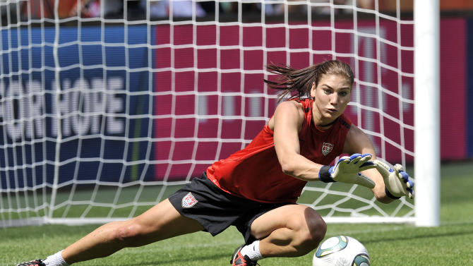 US goalkeeper Hope Solo stops a shot during the matchday –1 training of the United States on the eve of the semifinal match against France during the Women's Soccer World Cup in Moenchengladbach, Germany, Tuesday, July 12, 2011. (AP Photo/Martin Meissner)