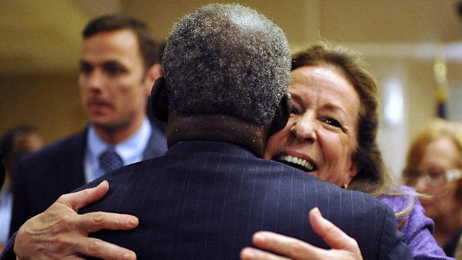 Democratic candidate Elizabeth Colbert Busch, right, hugs a supporter after the 1st Congressional District debate on Monday, April 29, 2013 in Charleston S.C. (AP Photo/Rainier Ehrhardt)