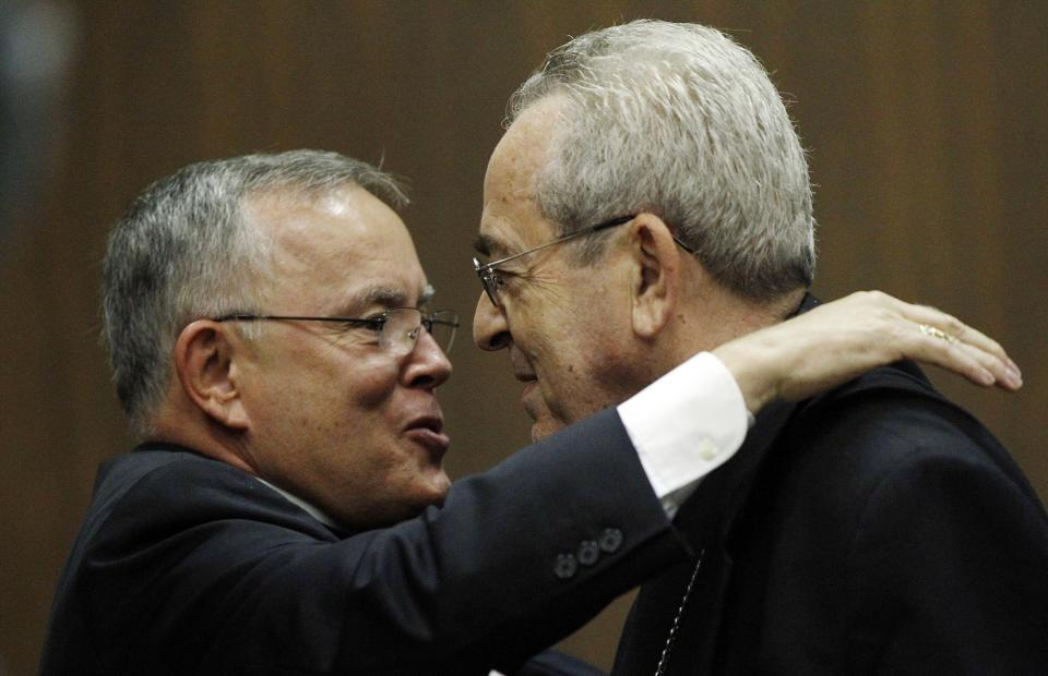 Denver Archbishop Charles Chaput, left, and Cardinal Justin Rigali embrace during a news conference Tuesday, July 19, 2011, in Philadelphia. The Vatican on Tuesday named Chaput Rigali's successor as Archbishop of Philadelphia. (AP Photo/Matt Rourke)