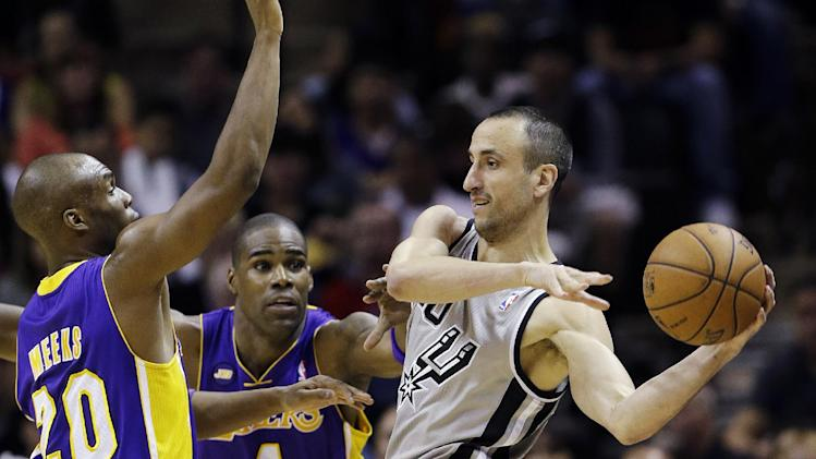 San Antonio Spurs' Manu Ginobili, right, of Argentina, is pressured by Los Angeles Lakers' Jodie Meeks (20) and Antawn Jamison (4) during the first half of Game 1 of their first-round NBA playoff basketball series, Sunday, April 21, 2013, in San Antonio. (AP Photo/Eric Gay)