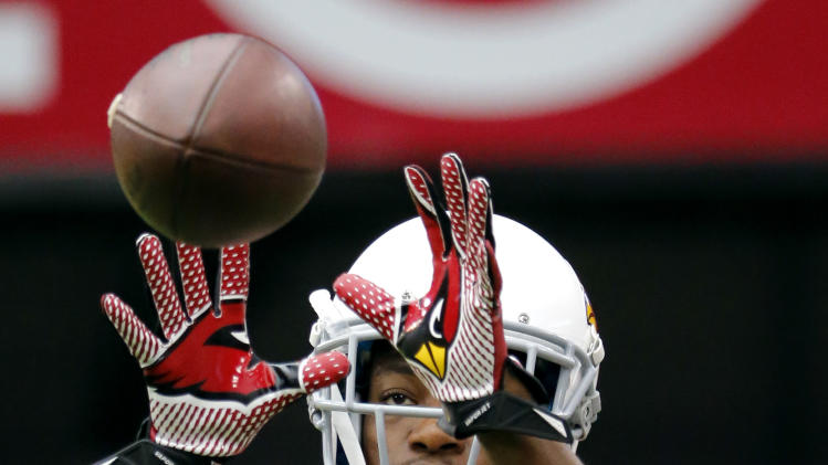 Arizona Cardinals' Andre Ellington (38) makes a catch during an NFL football training camp, Monday, July 28, 2014, in Glendale, Ariz. (AP Photo/Matt York)