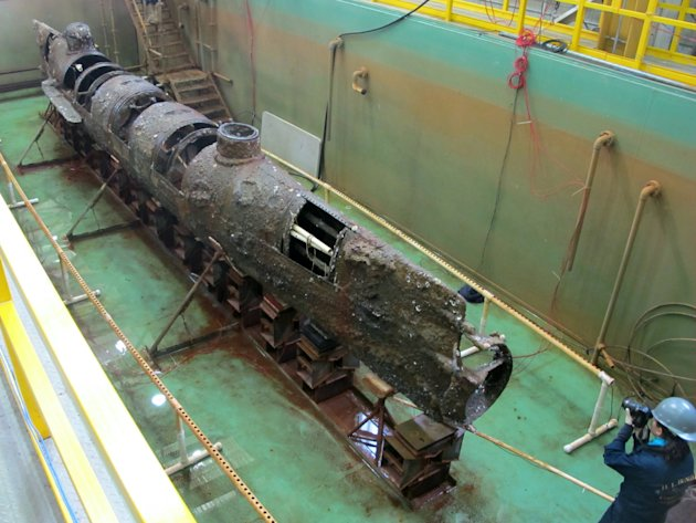 The Confederate submarine H.L. Hunley sits in a conservation tank after a steel truss that had surrounded it was removed in this Jan. 12, 2012 file photo taken at a conservation lab in North Charlesto