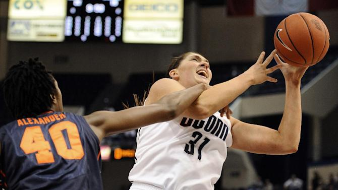 Connecticut's Stefanie Dolson, right, is fouled by Syracuse's Kayla Alexander in the first half of an NCAA college basketball game in the semifinals of the Big East Conference women's tournament in Hartford, Conn., Monday, March 11, 2013. (AP Photo/Jessica Hill)