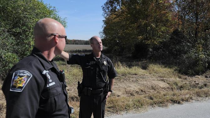 Sheriff J. Daversa and Sgt.  Moody stand where the body was found in Fayetteville, Tenn., Tuesday, Oct. 23, 2012. Sources report that a body found today in Hazel Green may also be connected to the murders in Lincoln County. (AP Photo/The Huntsville Times, Sarah Cole)