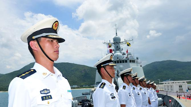 Chinese naval soldiers stand on China's missile destroyer Haikou at a naval port in Hainan Province