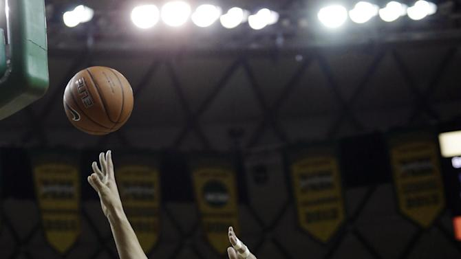 Baylor center Brittney Griner (42) shoots against Kansas State guards Heidi Brown (10) and Brittany Chambers during the first half of an NCAA college basketball game Monday, March 4, 2013, in Arlington, Texas. (AP Photo/LM Otero)