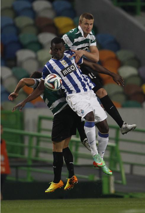 Sporting's Dier and Rojo fight for the ball with Porto's Martinez during their Portuguese premier league soccer match at Alvalade stadium in Lisbon