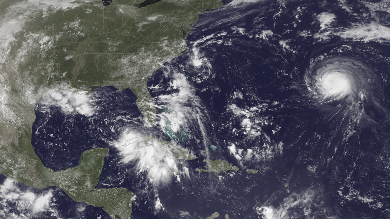 Storm bears down on Florida, hurricane threatens Hawaii