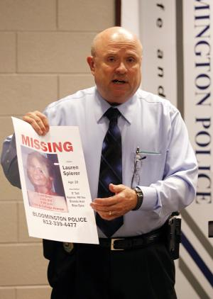 Lt. Bill Parker displays the missing person poster of Lauren Spierer, 20, who disappeared around 4:30 a.m.  Friday during a news conference in Bloomington, Ind., Tuesday, June 7, 2011.  The family, police and hundred of volunteers continue to search for the missing Indiana University student.  (AP Photo/Michael Conroy)