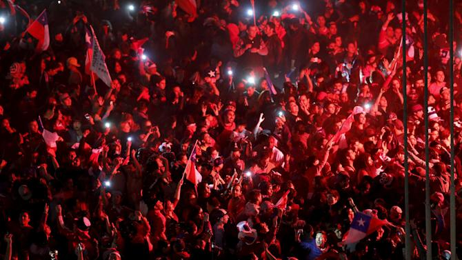 Chile's fans celebrate after winning the final of the Copa America soccer tournament against Argentina in Plaza Italia in Santiago