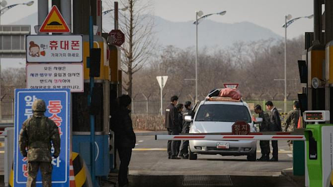A vehicle leaving the Kaesong joint industrial zone passes through a checkpoint near the Demilitarized Zone (DMZ) separating North an South Korea on February 11, 2016