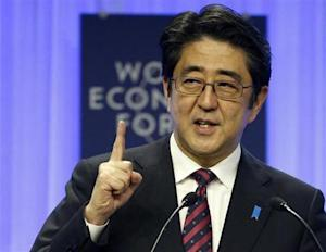 Japan's Prime Minister Abe addresses session of WEF in Davos