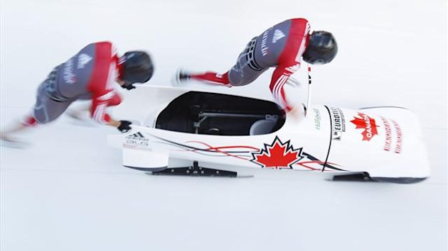 Canada's pilot Lyndon Rush (R) and brakeman Jesse Lumsden start during the third run of the 2-men competition (Reuters)