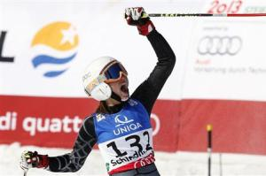 Jacky Chamoun of Lebanon celebrates at the finishing line during the first run of the women's Giant Slalom race at the World Alpine Skiing Championships in Schladming