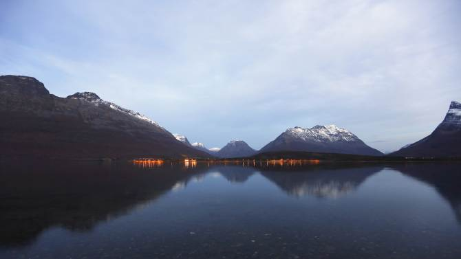 A view of Lyngen-Fiord and the snow-capped Lyngen Alps near the village of Furuflaten, north of the Arctic Circle