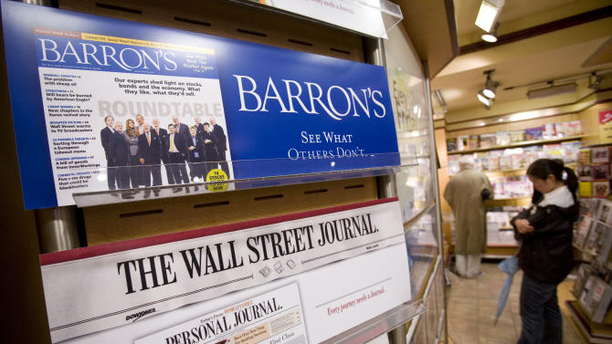 """This Monday, July 23, 2007, file photo shows advertising for on a New York newsstand.  Facebook Inc.'s stock took a hit Monday, Sept. 24, 2012, after an article in Barron's said it is """"still too pricey"""" despite a sharp decline since its initial public offering.  (AP Photo/Mark Lennihan, File)"""