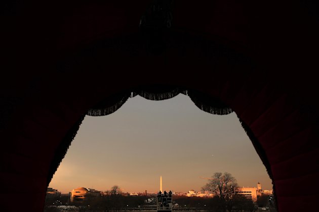 The sun rises on Capitol Hill, looking toward the Washington Monument in Washington, Monday, Jan. 21, 2013, prior to the start of the 57th Presidential Inaugural. President Barack Obama will take part in a ceremonial swearing in ceremony Monday. (AP Photo/Win McNamee, Pool)