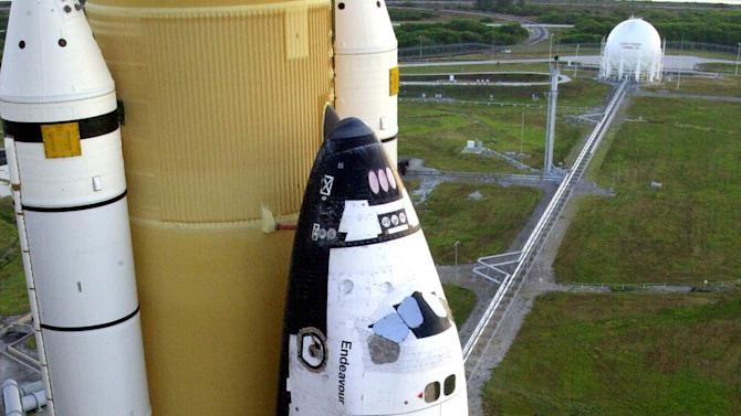 FILE - An Oct. 12, 2002 file image provided by NASA shows the space shuttle Endeavour sitting on the launch pad at the Kennedy Space Center in Cape Canaveral, Fla. With the space shuttles retired, Endeavour will head to the California Science Museum in the fall. The museum announced it has raised nearly half of its $200 million fundraising goal for a new exhibit to house Endeavour. (AP Photo/NASA, Kim Shiflett, File)
