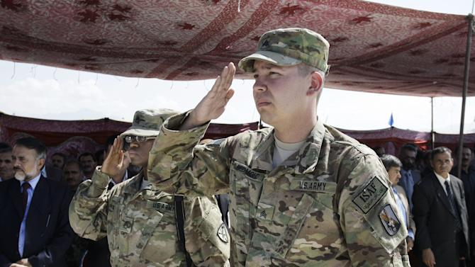 U.S. soldiers, part of the NATO- led International Security Assistance Force (ISAF) salute during a hand over ceremony of U.S.- run prison to Afghan government in Bagram north of Kabul, Afghanistan, Monday, Sept. 10, 2012. U.S. officials handed over formal control of Afghanistan's only large-scale U.S.-run prison to Kabul on Monday, even as disagreements between the two countries over the thousands of Taliban and terror suspects held there marred the transfer. (AP Photo/Musadeq Sadeq)