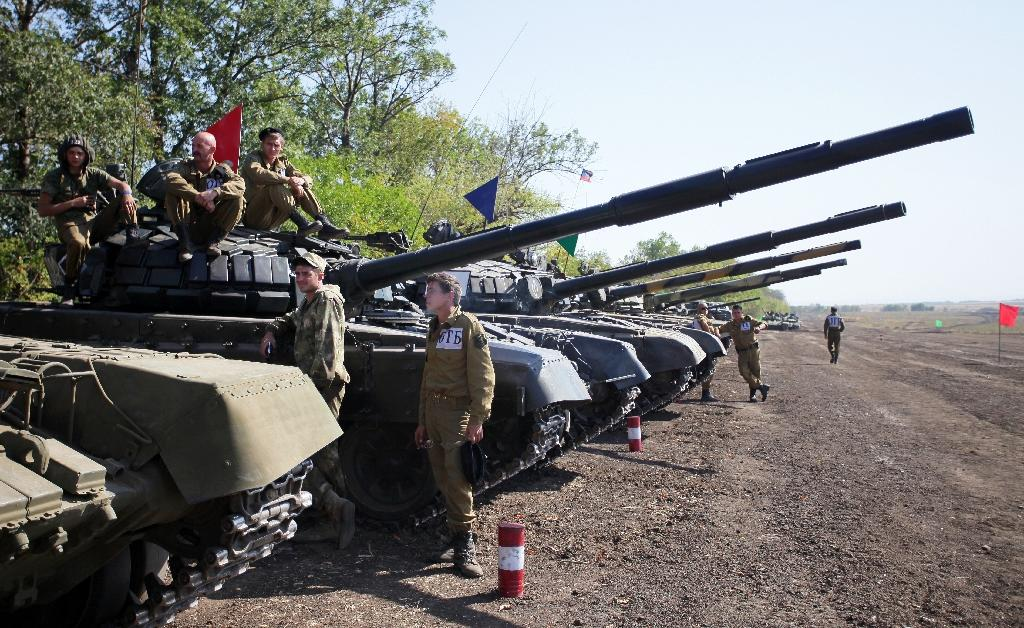 Ukraine warring sides announce start of small arms withdrawal