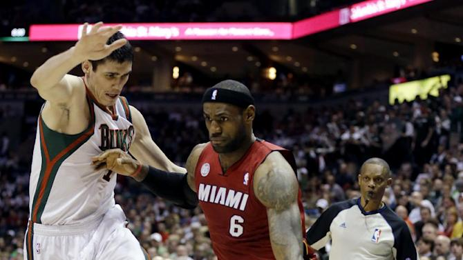 Miami Heat's LeBron James (6) drives against Milwaukee Bucks' Ersan Ilyasova during the first half of Game 4 in a first-round NBA basketball playoff series, Sunday, April. 28, 2013, in Milwaukee. (AP Photo/Jeffrey Phelps)
