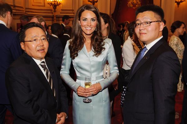 Catherine, Duchess of Cambridge poses with President of Mongolia Elbegdorj Tsakhia (L) during a reception at Buckingham Palace a reception for Heads of State and Government attending the Olympics Open
