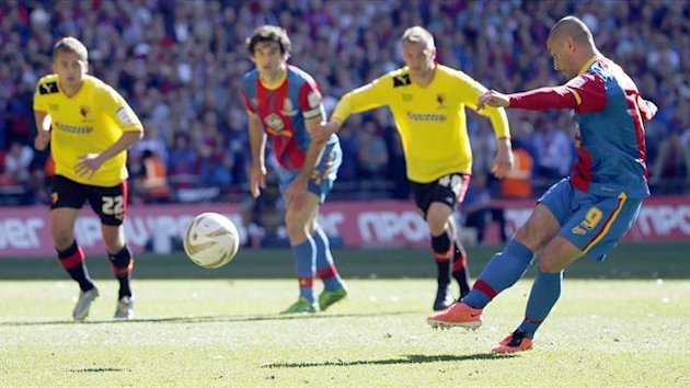 Crystal Palace's Kevin Phillips (R) shoots and scores from the penalty spot against Watford during their Championship play-off final (Reuters)