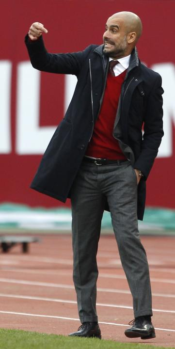 Bayern Munich's coach Guardiola gestures during German Bundesliga soccer match against Nuremberg in Nuremberg