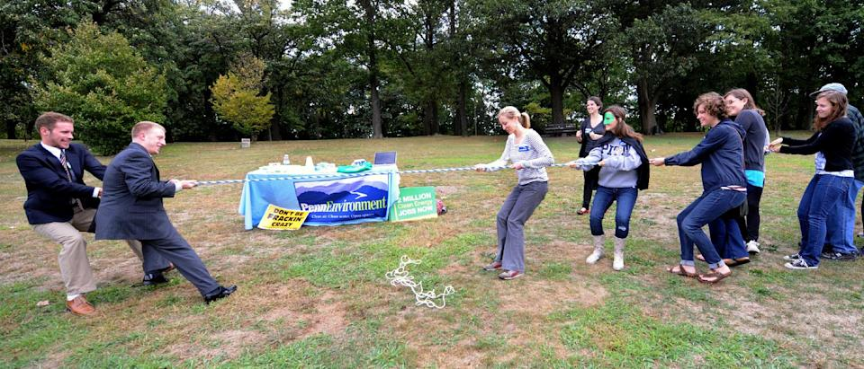 "Local groups from Pittsburgh take part in a Frackdown Smackdown tug-of-war between college students representing the ""gas industry"" and Pennsylvania citizens during a global Frackdown Day Schenley Park in Pittsburgh, Saturday, Sept. 22, 2012.  (AP Photo/John Heller)"